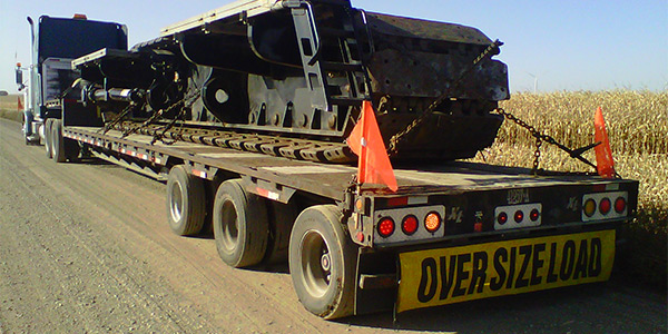 back view of truck hauling equipment